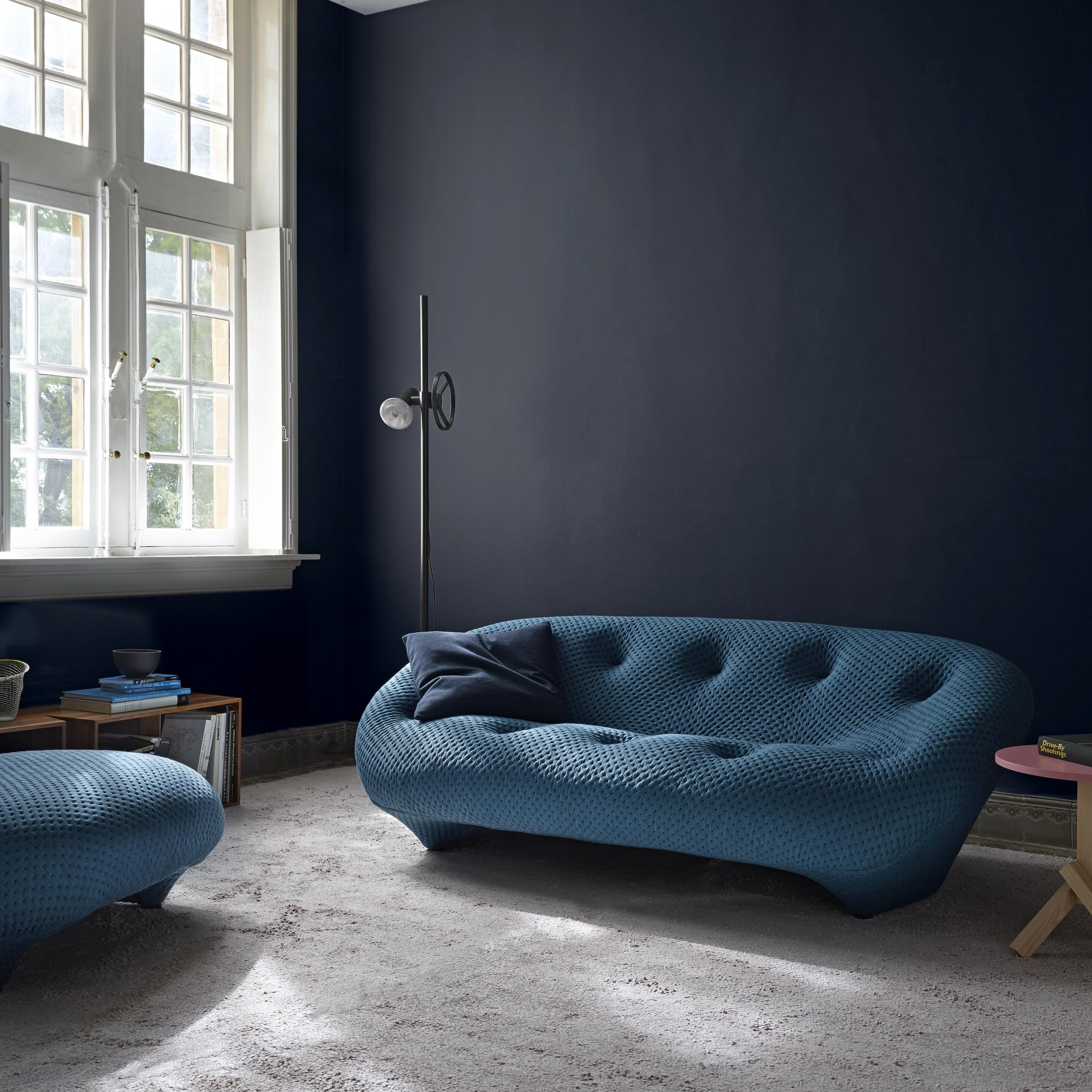 a very modern curved blue sofa