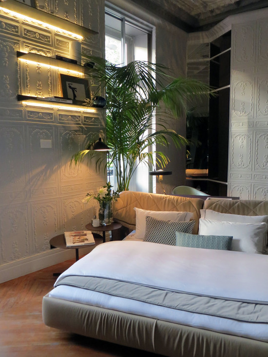 The plant tree complements the bedroom decoration.