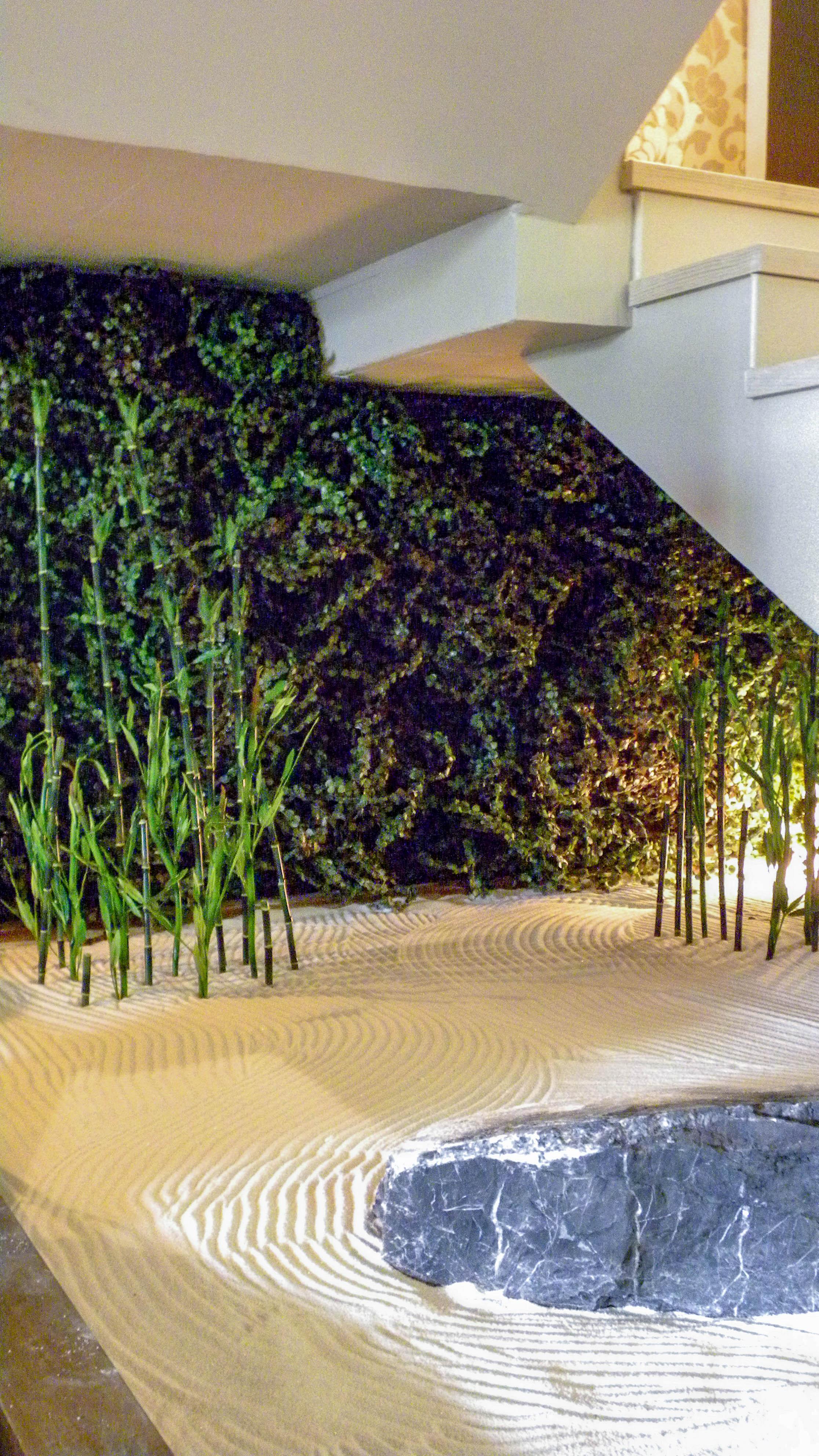 Zen garden under the staircase.