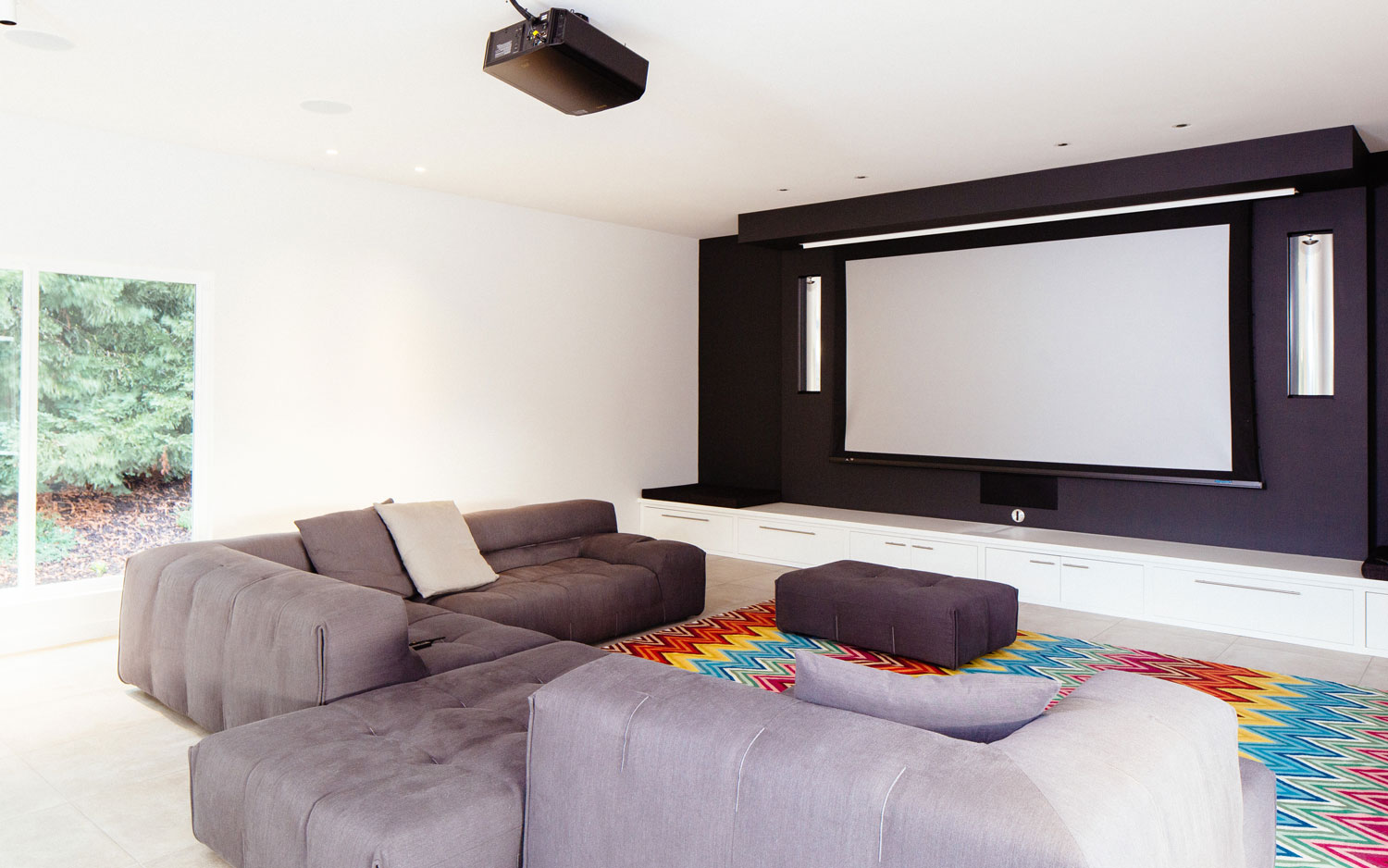 the tufty too sectional creates an informal seating area for the home theater.