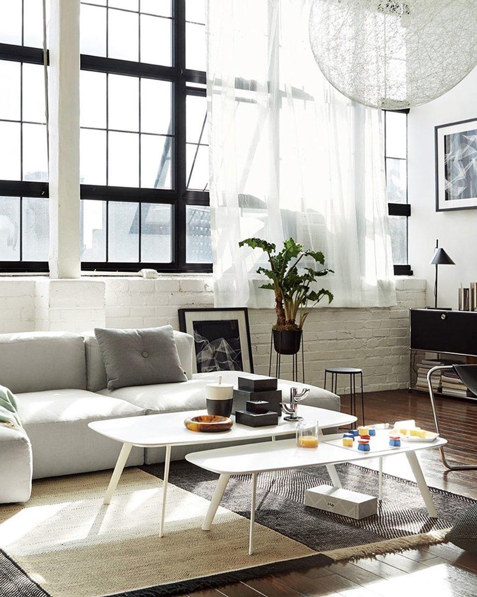 stua sofa and plants living room