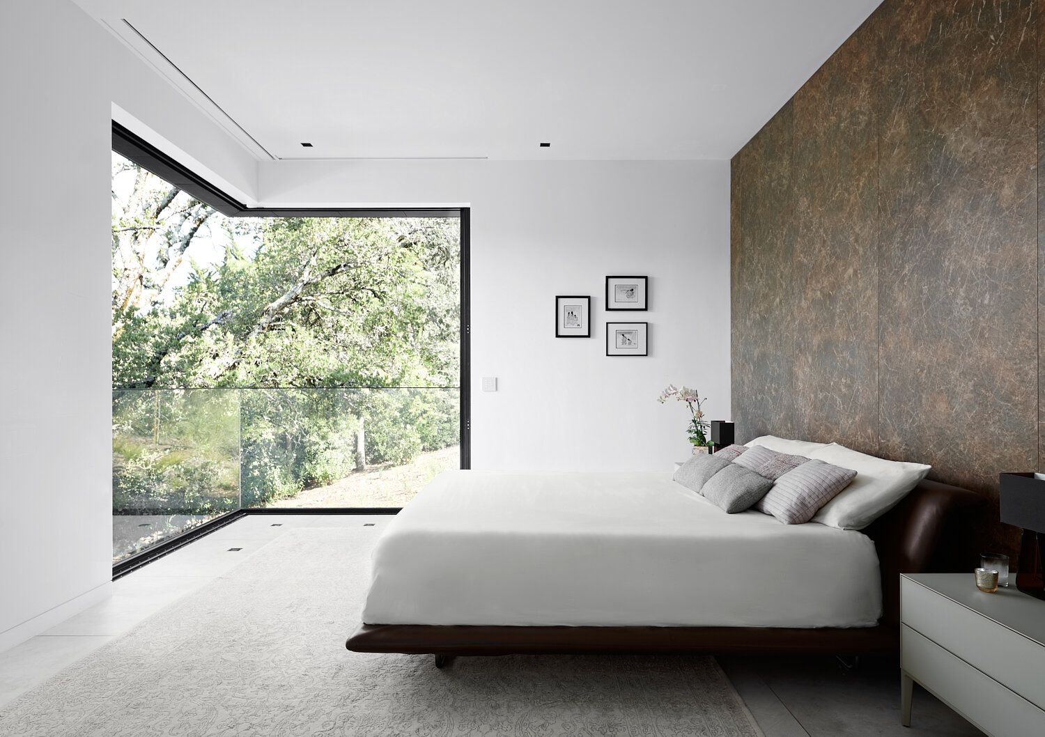 master bedroom with Neolith wall