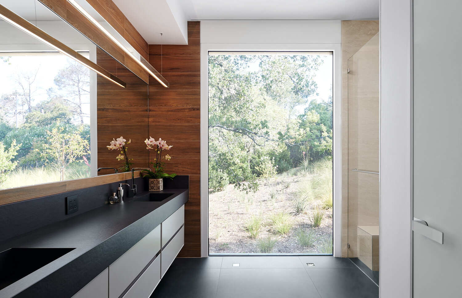 Master bathroom with black counter