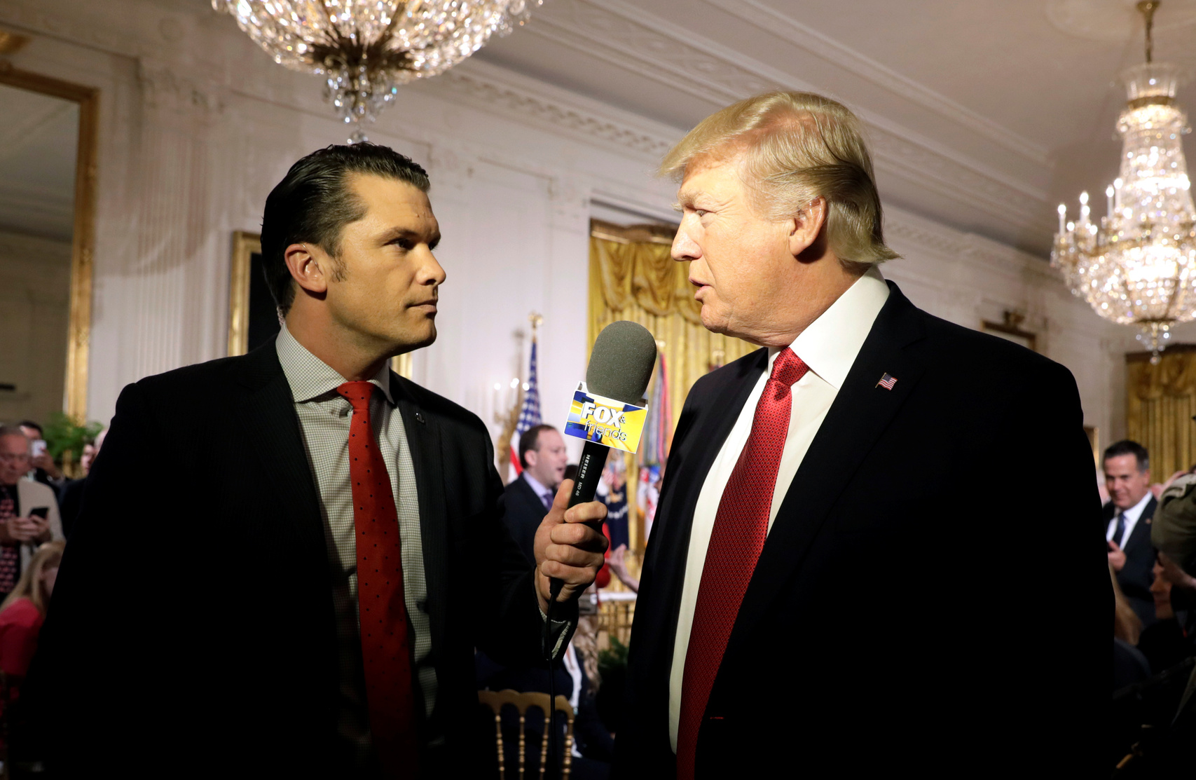 President Donald Trump is interviewed by Fox & Friends host Pete Hegseth, the former executive director of the Concerned Veterans for America.