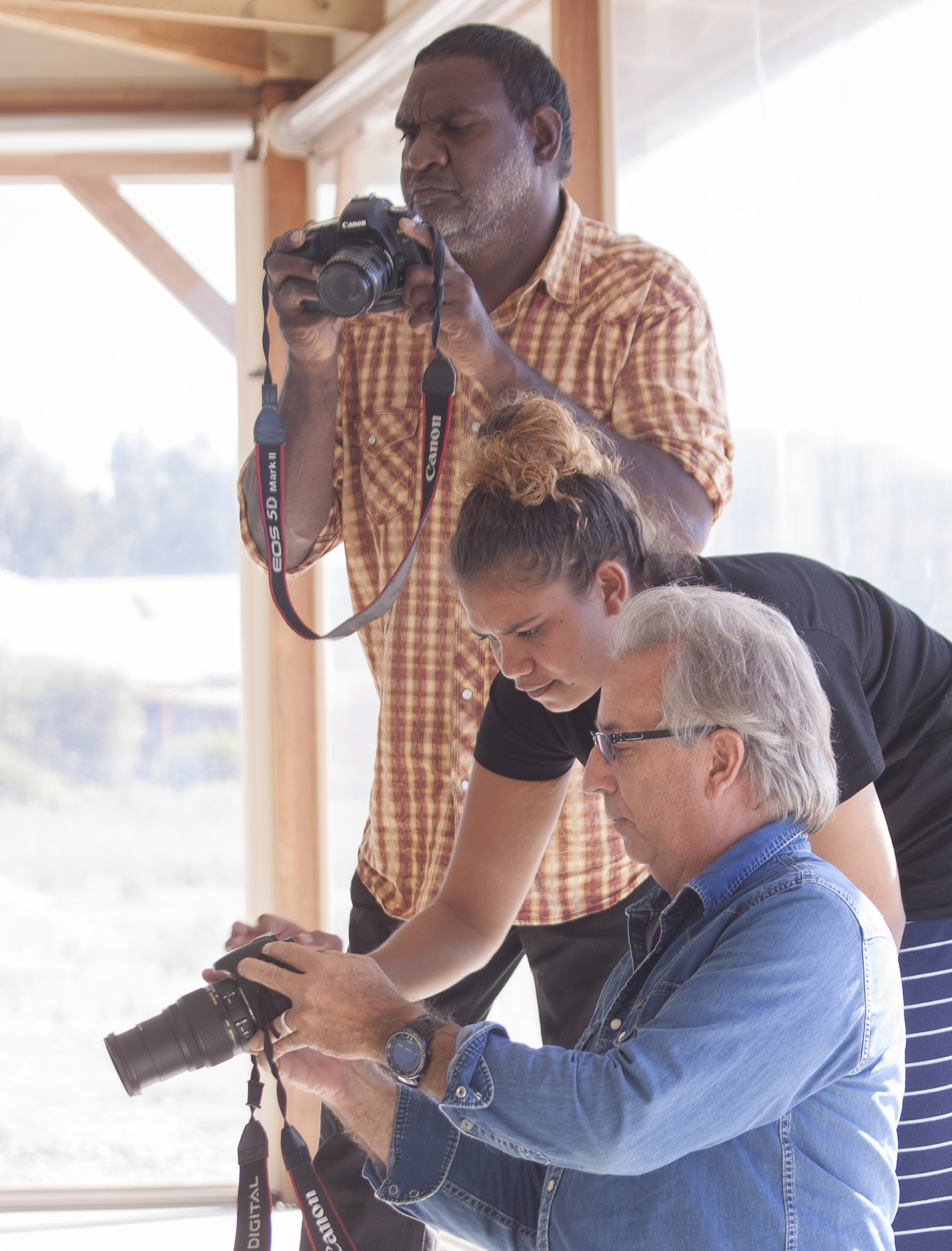 Clayton Cherel, Cecilia Umbagai and David Dare Parker during the 'Photographing People' workshop.