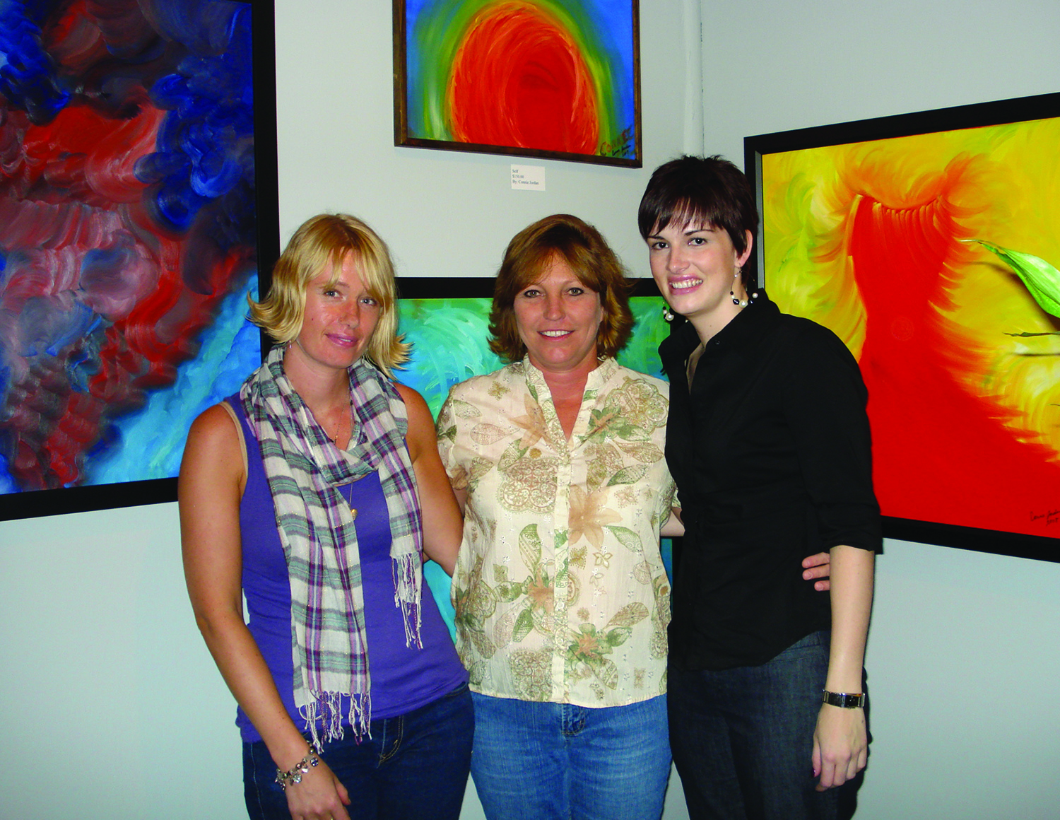 DENISE BUISMAN-PILGER FROM HOLLAND AND TANJA DUGAS (RIGHT) FROM GERMANY, along with gallery owner Connie Jordan, bring a diverse display of artistic creation at the Jordan Art Gallery on Beaton Street.
