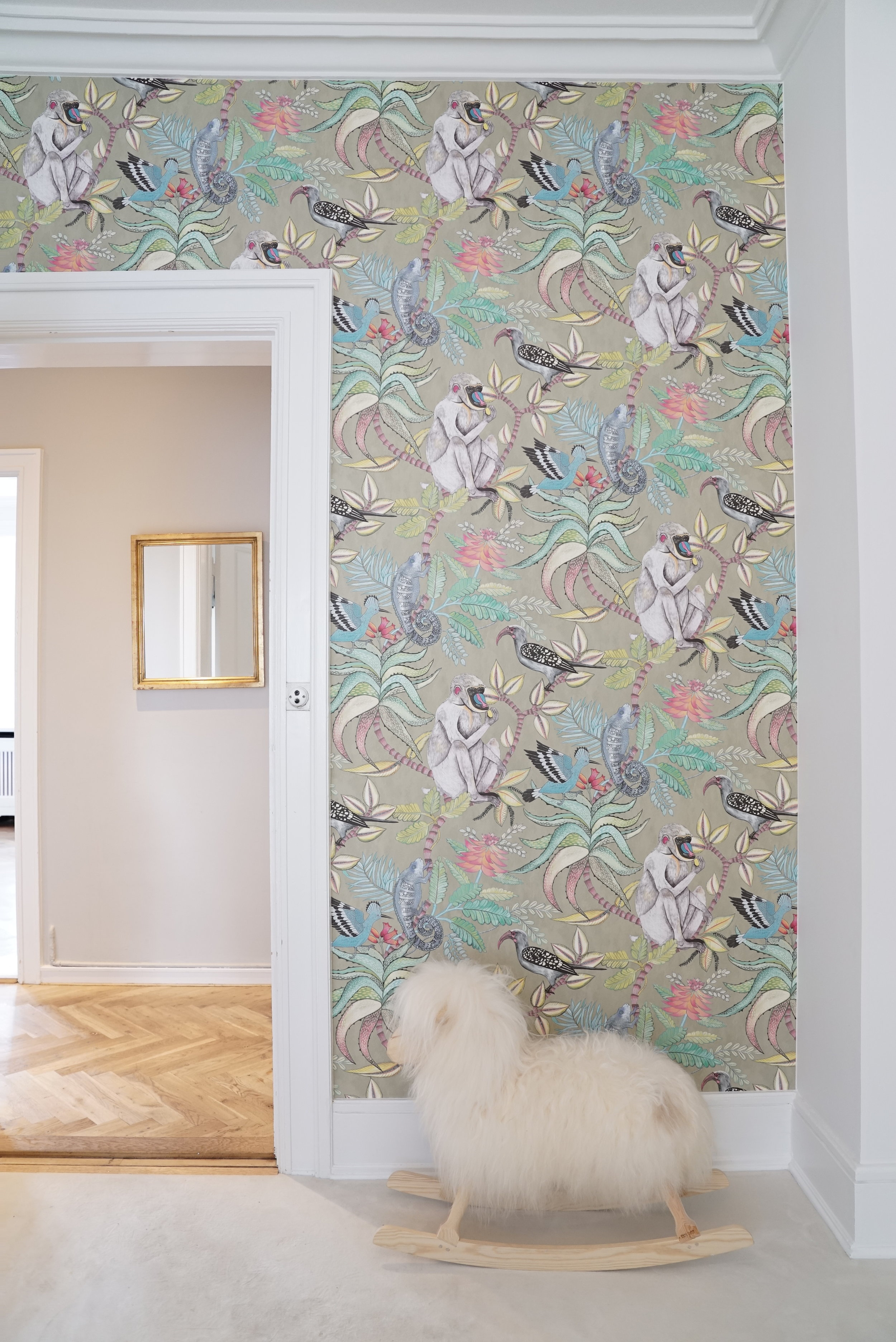The wallpaper on the wall adding colour and warmth