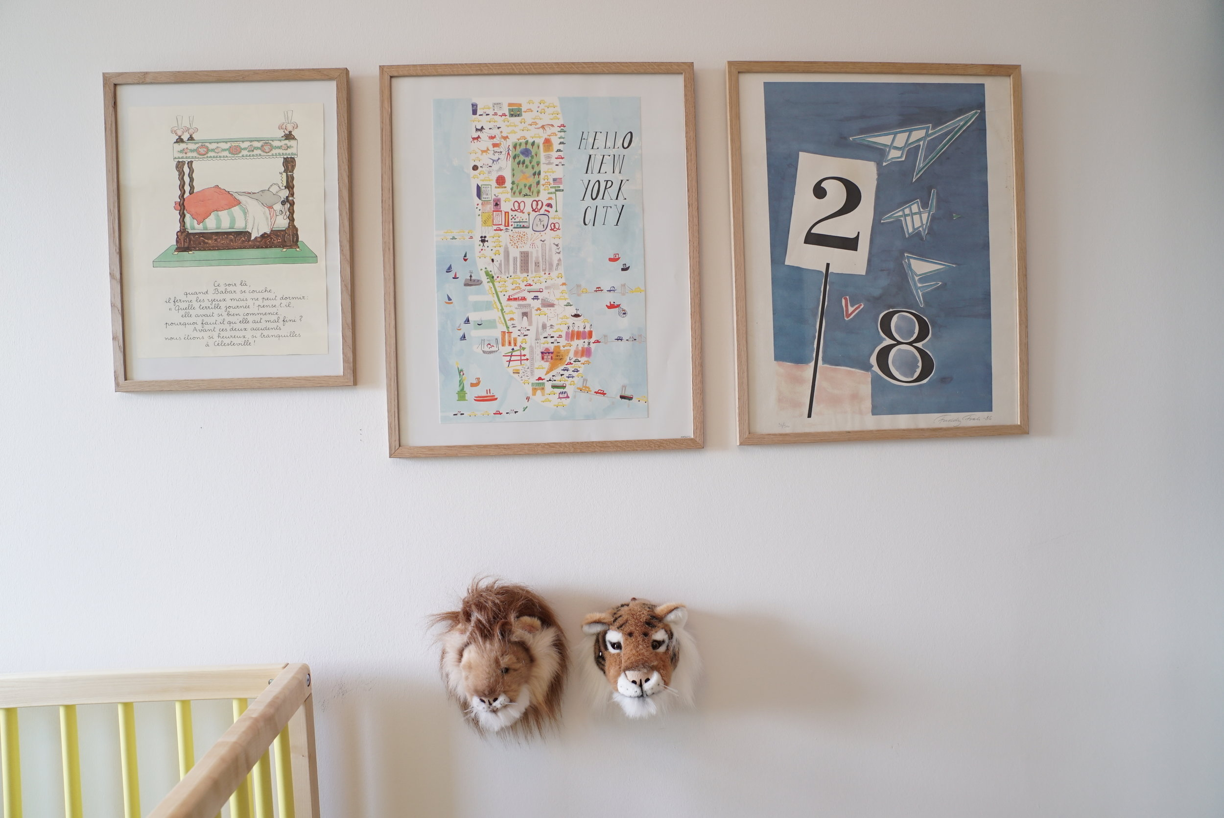Animals heads and art on the wall next to and above the Caravan Crib