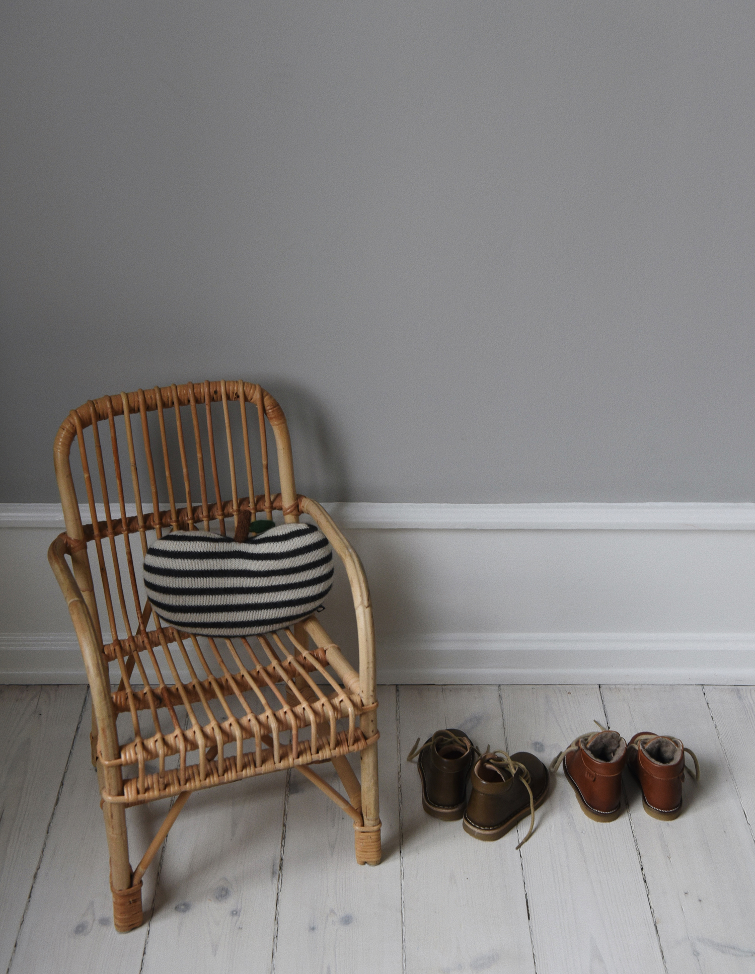 The striped  Apple Pillow  from Oeuf NYC and some of Walter and Holger's shoes.