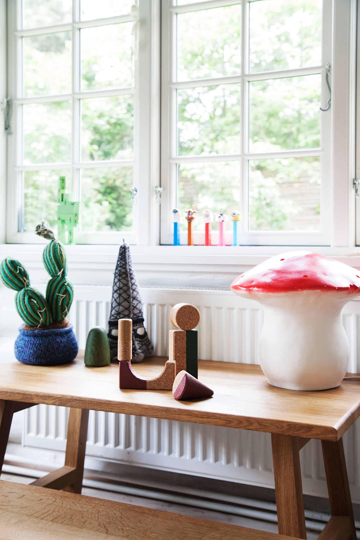 Creative Cork Toys , a large  Mushroom Lamp  and the  Tre Wooden Toy  are found on the  Oak Play Table .