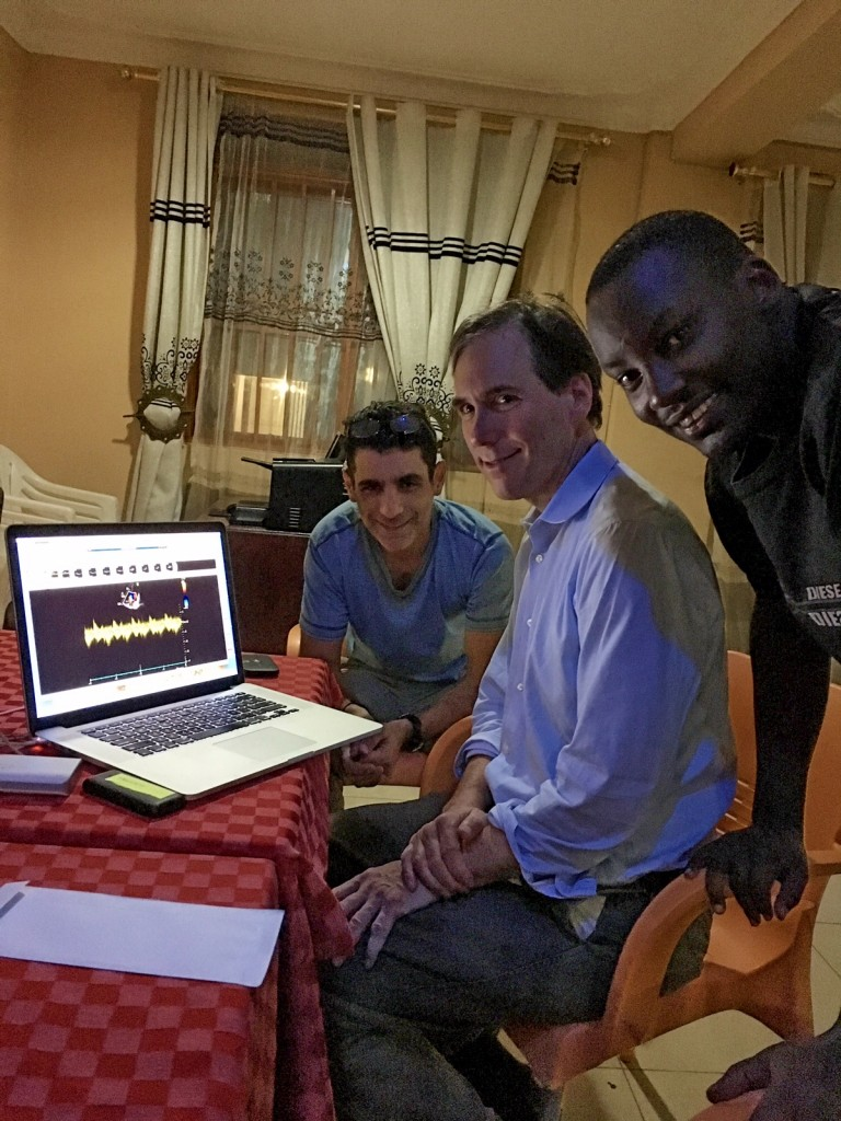 Sam, Craig and Allan smile as they view still images come through to McKesson from the RHD study. (Mubende District, Uganda).