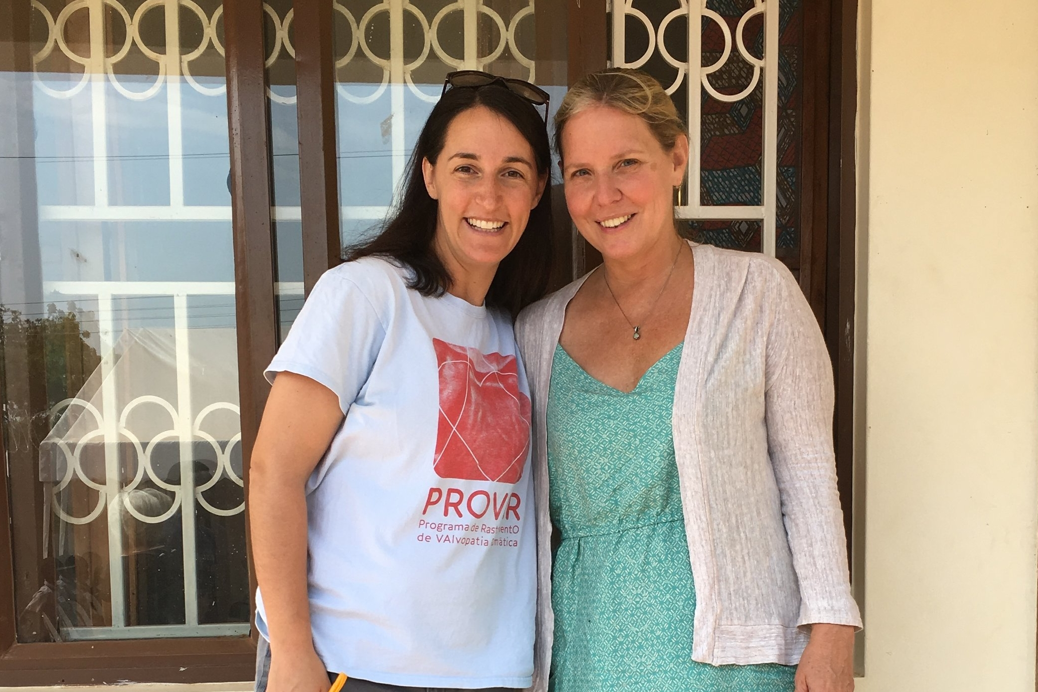 Andrea Beaton, left, the article's lead author, at the Rheumatic Heart Disease Clinic in Gulu, Uganda, together with Imaging the World president Kristen Destigter.