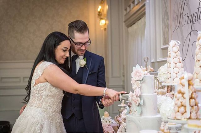 Happy one year anniversary to Krystal and Kevin🎉💕! I love this picture of you cutting your cake in front of the sweet table at your beautiful wedding💖  #theartofsweets #sweetstable #sweettable #desserttable #dessert #sweets #wedding #weddingsweettable #weddingcake #cake #macarons #cakepops #macarontower #blush #spoilyourguests #torontoweddings #toronto #gta #mrandmrs