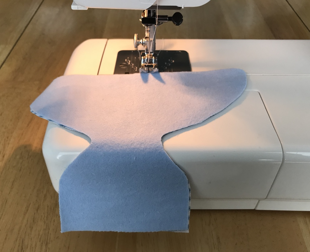You will want to start your sewing at the widest part of the dia- per (also known as the back)