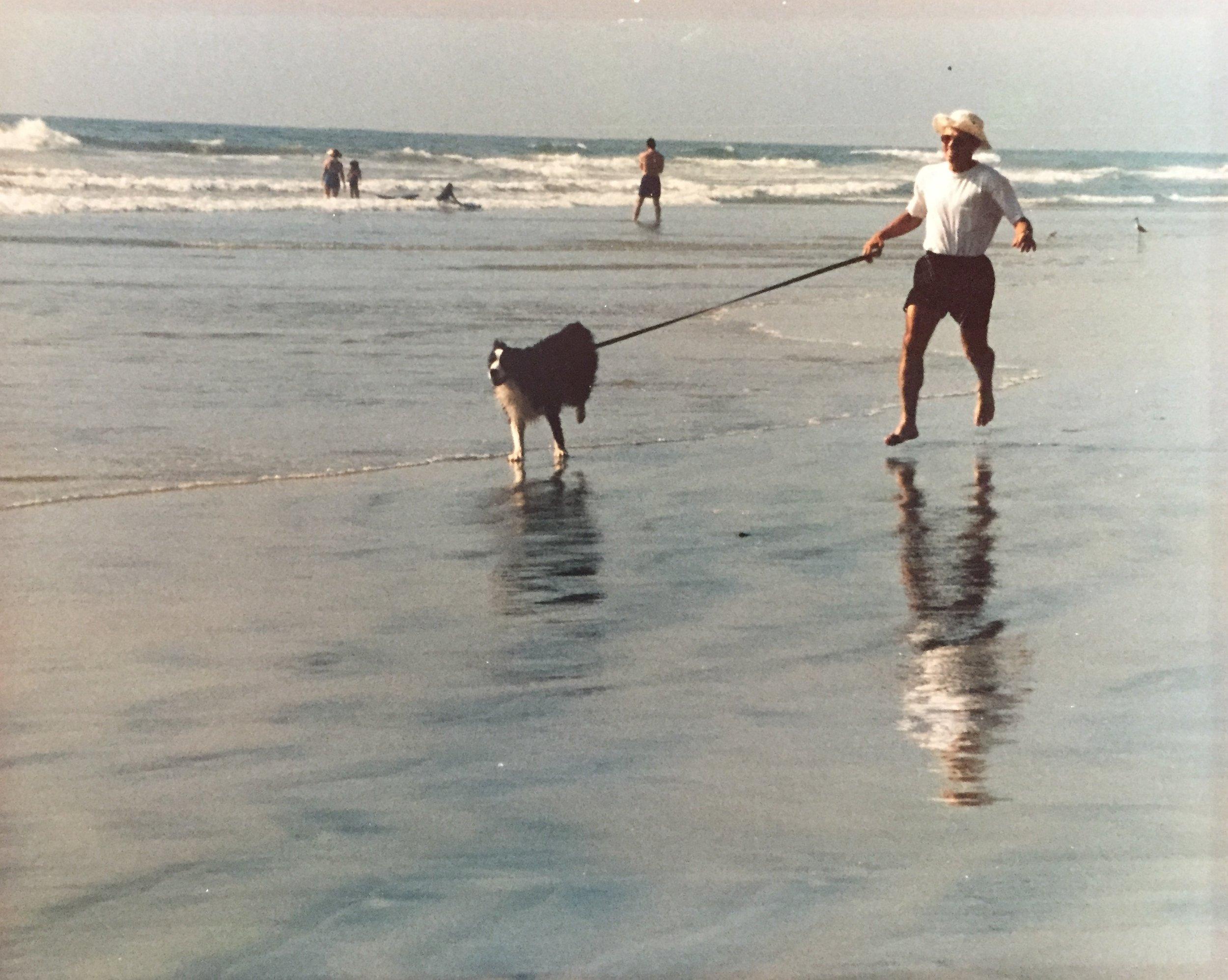 Dad and Nikka running on Moonlight Beach in Encinitas, CA, his hometown