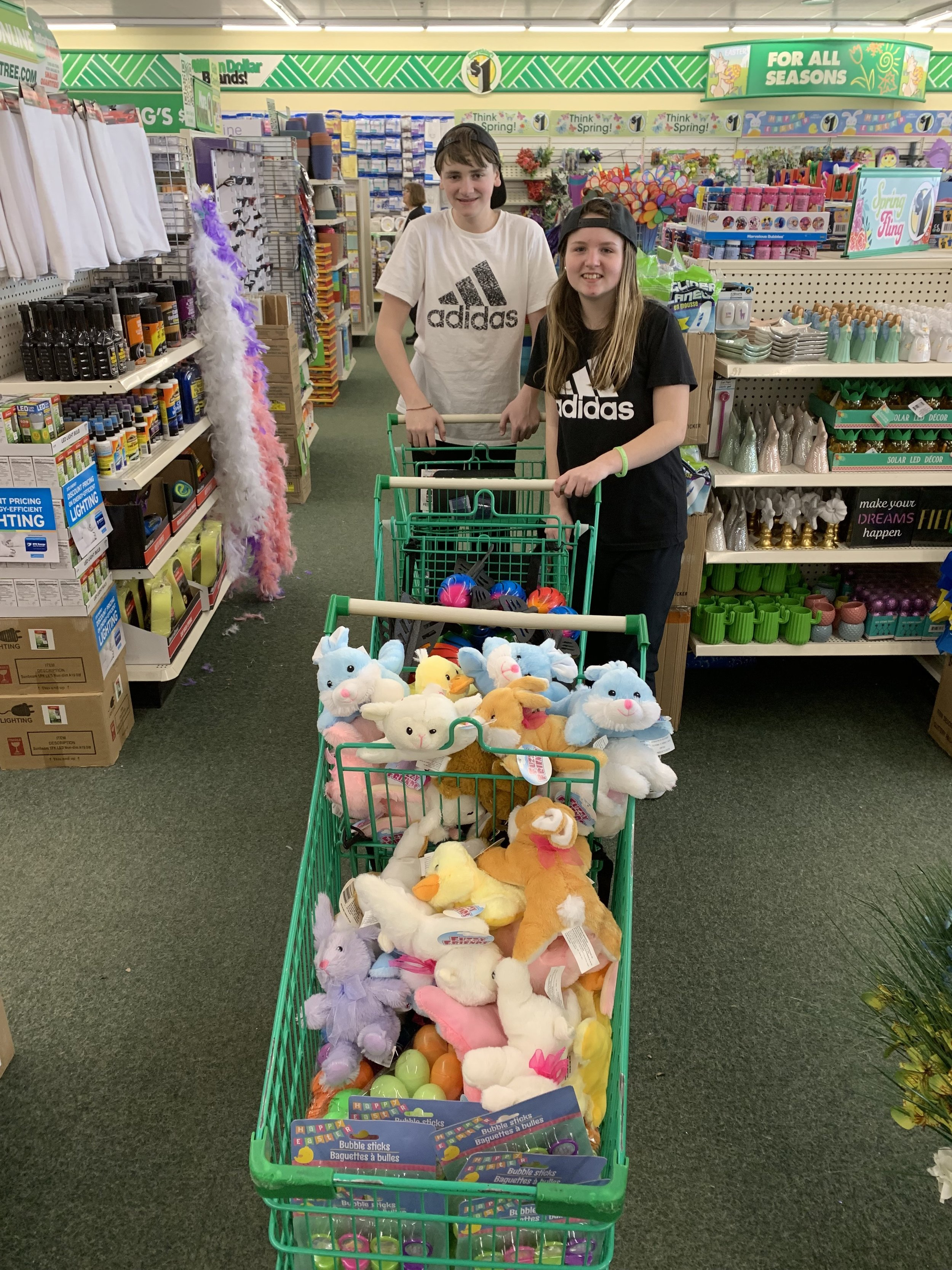 Joey Johnston (Pete & Paula's youngest son) and his friend, Desiree, helping shop for the Easter baskets.
