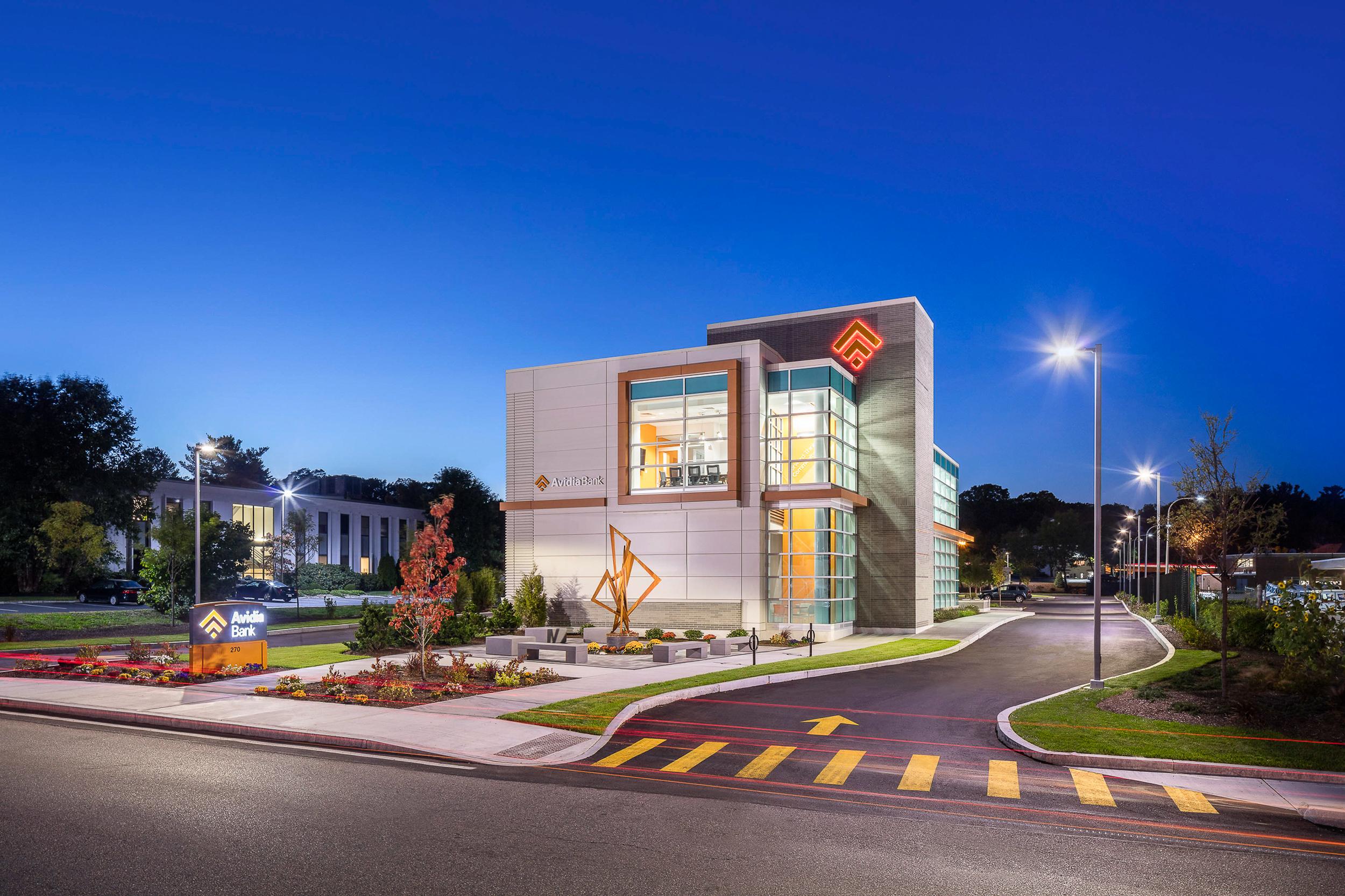 Avidia Bank at dusk Framingham MA, architectural design by Studio Q Architecture.