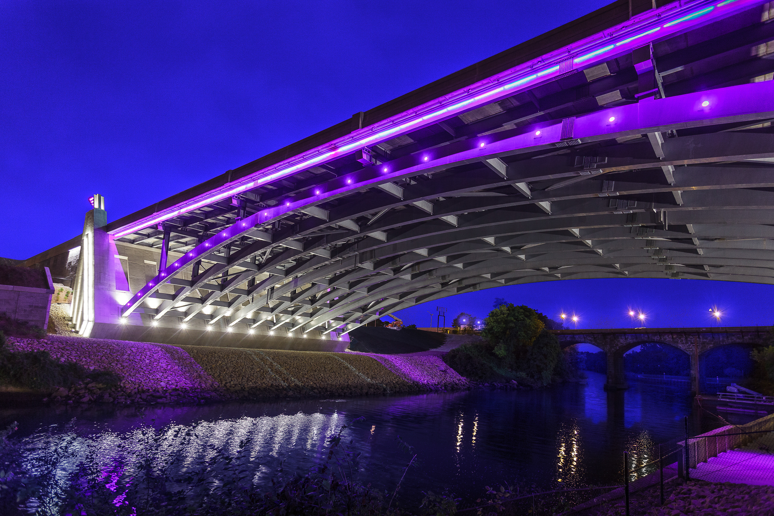 Pawtucket River Bridge at dusk by Northeast Collaborative Architects.  Pawtucket, RI.