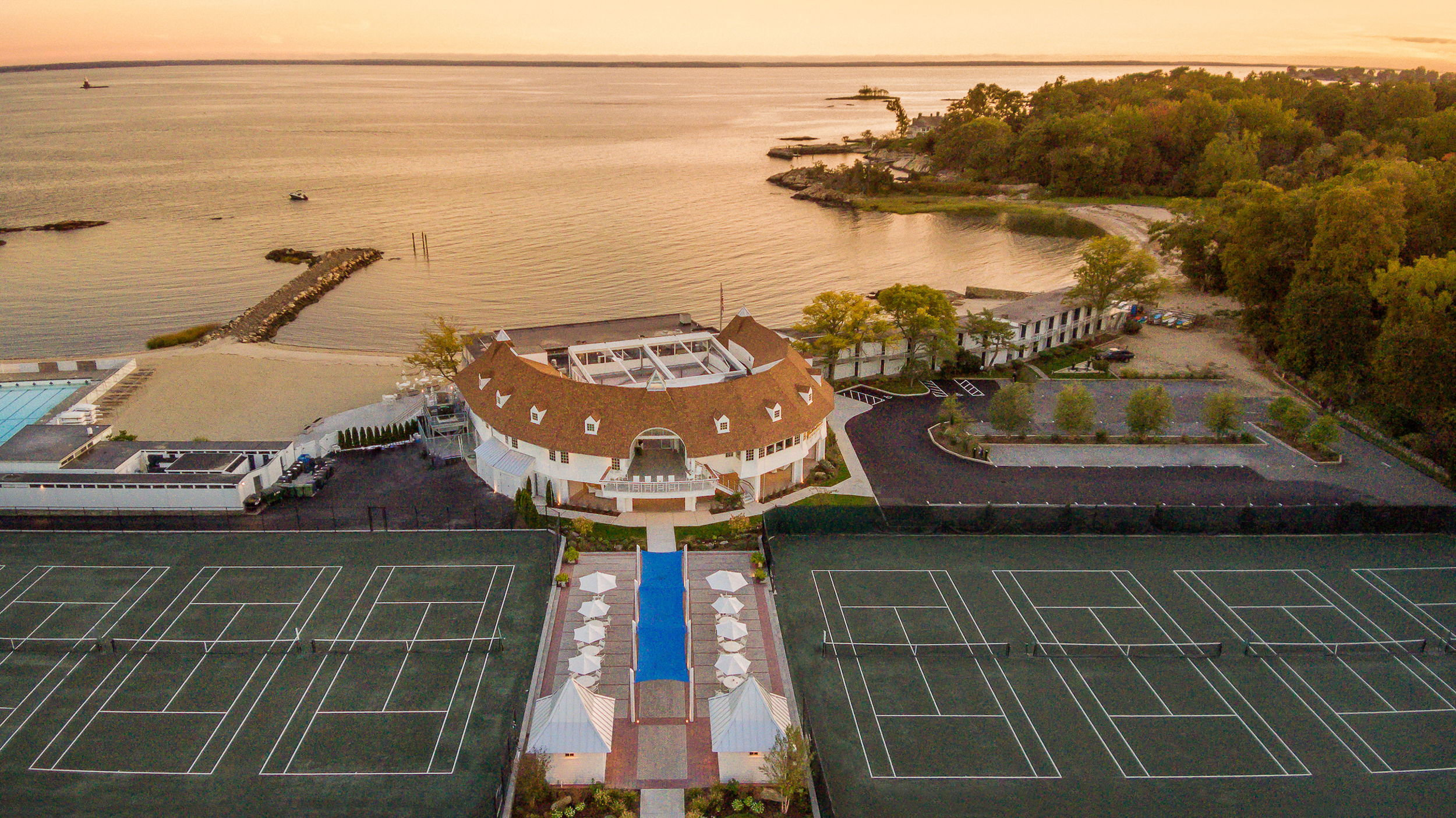 Drone aerial of the Tokeneke Beach Club at sunset in Darien, CT. Architectural design by PBS Architects and Rogers McCagg Architects.