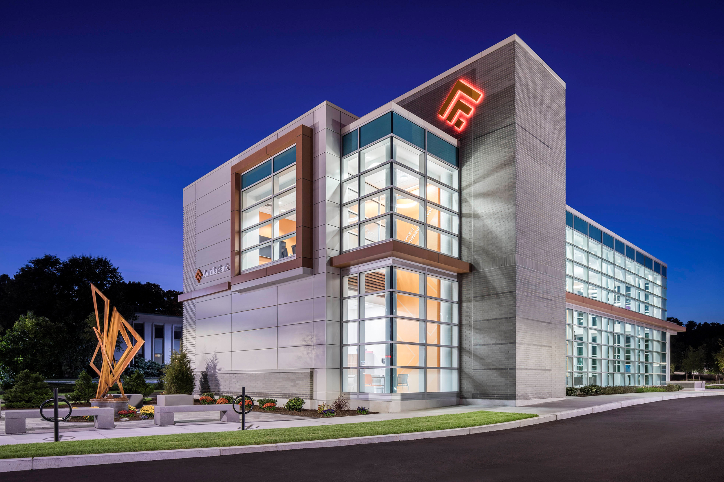 Avidia Bank at dusk in Framingham MA. Architectural designby Studio Q Architecture.