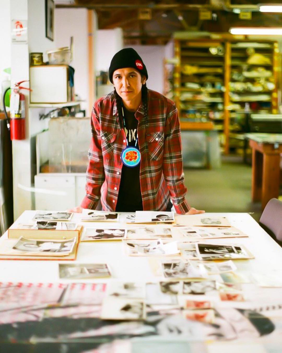 Keith Secola at Kala Art Institute with his archive of family photographs. Photograph by Amelia Berumen