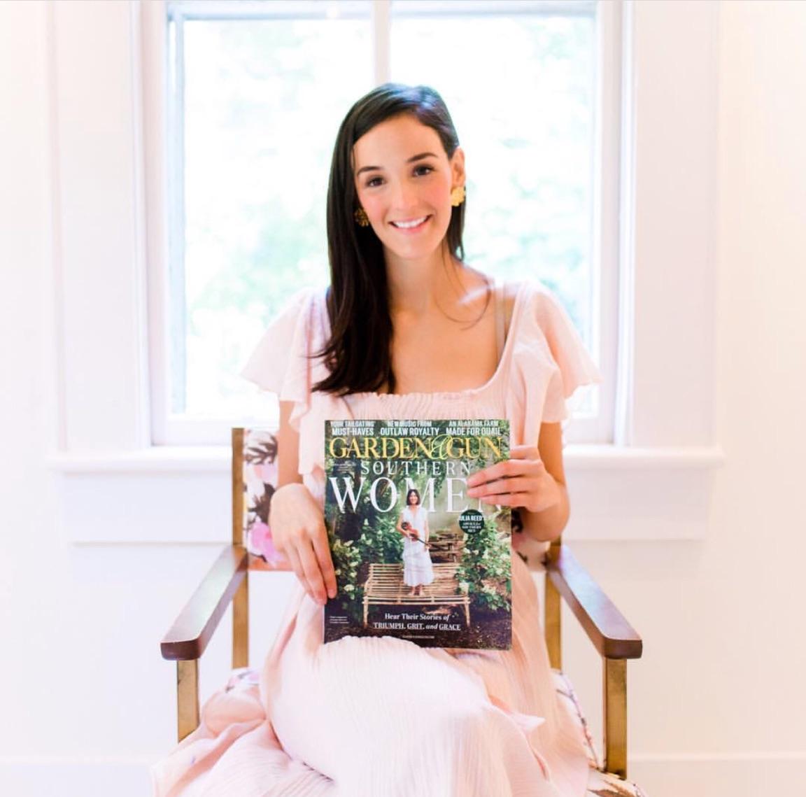 Shain holding a copy of Garden & Gun Magazine
