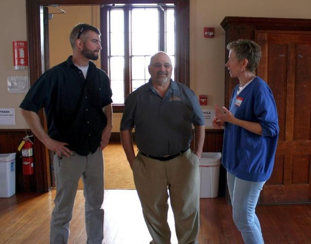 L to R: Kevin O'Neil (Austin Design), Mike Lapomardo Jr. (Antonaelli Construction), and Evy Dueck (1870 Town Hall Advisory Committee) confer during the April 13 Open House in Berlin, MA. Photo Ken Cleveland