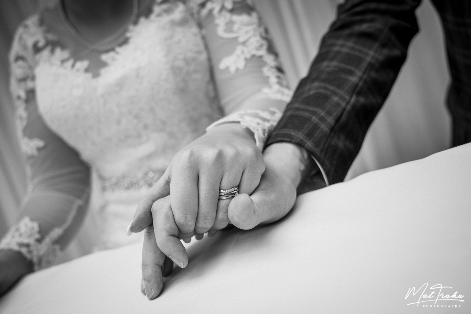 rings-holding-hands-white-heart-inn-moorwood-alfreton-wedding-photographer-photography-sunset-venue