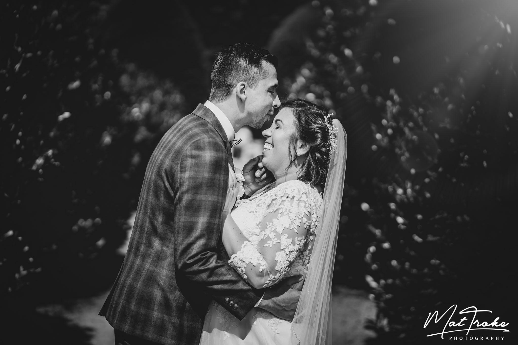 rufford_mill_venue_wedding_kissing_photography_beautiful_bride