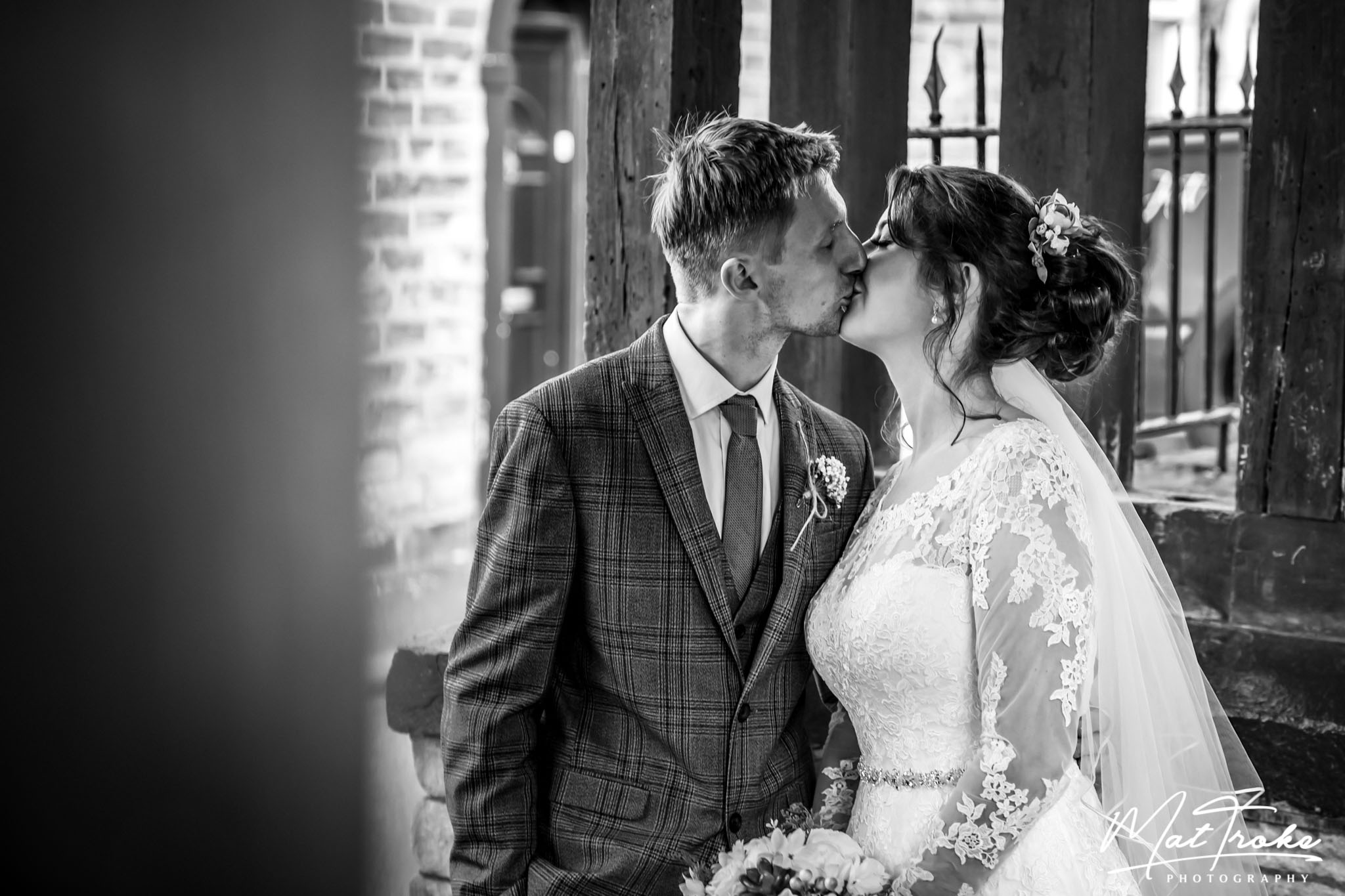 glossop-crystal-ballroom-wedding-bride-groom-kissing-photographer-photography-married-church