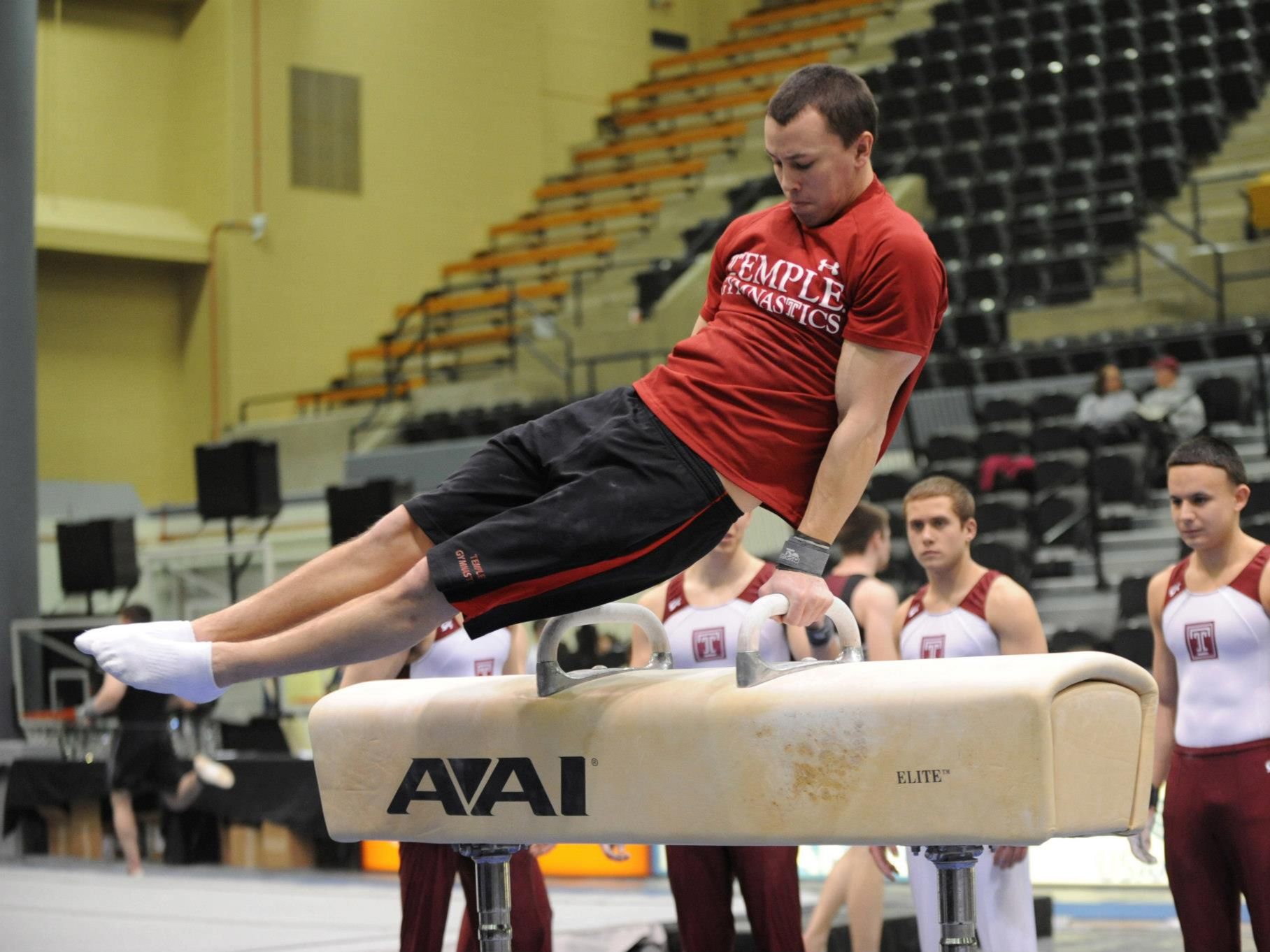 Allan on the pommel horse during the West Point Open in January 2013 while attending Temple University.