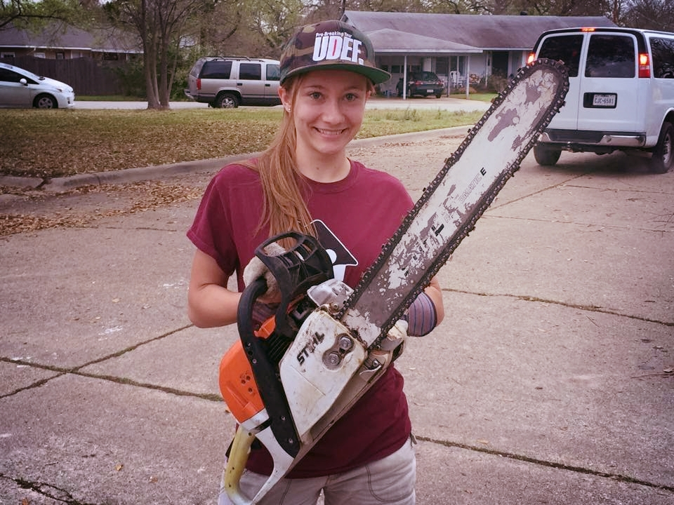 Happy Girl with Chainsaw.jpg