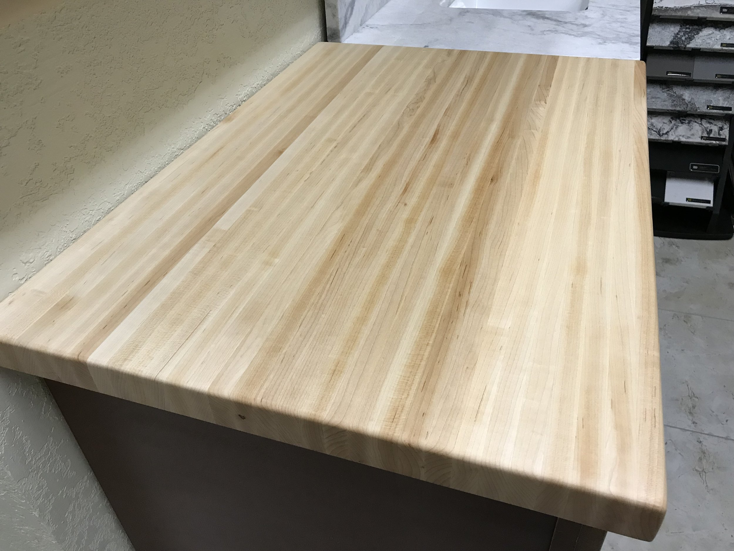Hard Maple Butcher Block - Face-grain Hard Maple with a coat of clear, food grade mineral oil brings out the natural beauty of this light, honey-colored wood, giving your kitchen countertop or island an beautiful, natural look and feel. Easy to clean, easy to maintain and ages well with decades of use.