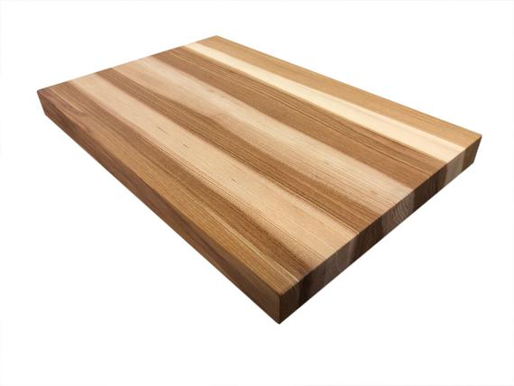 Hickory Butcher Block - The heart-wood in Hickory will bring bold colors that will give your countertop or island tremendous character. When oiled, it has soft, honey-colored summer wood, with the contrast of the darker heart-wood and provides unique blended beauty. Standard countertop or island comes with hand-rubbed, food grade mineral oil, in maximum lengths of 12'.