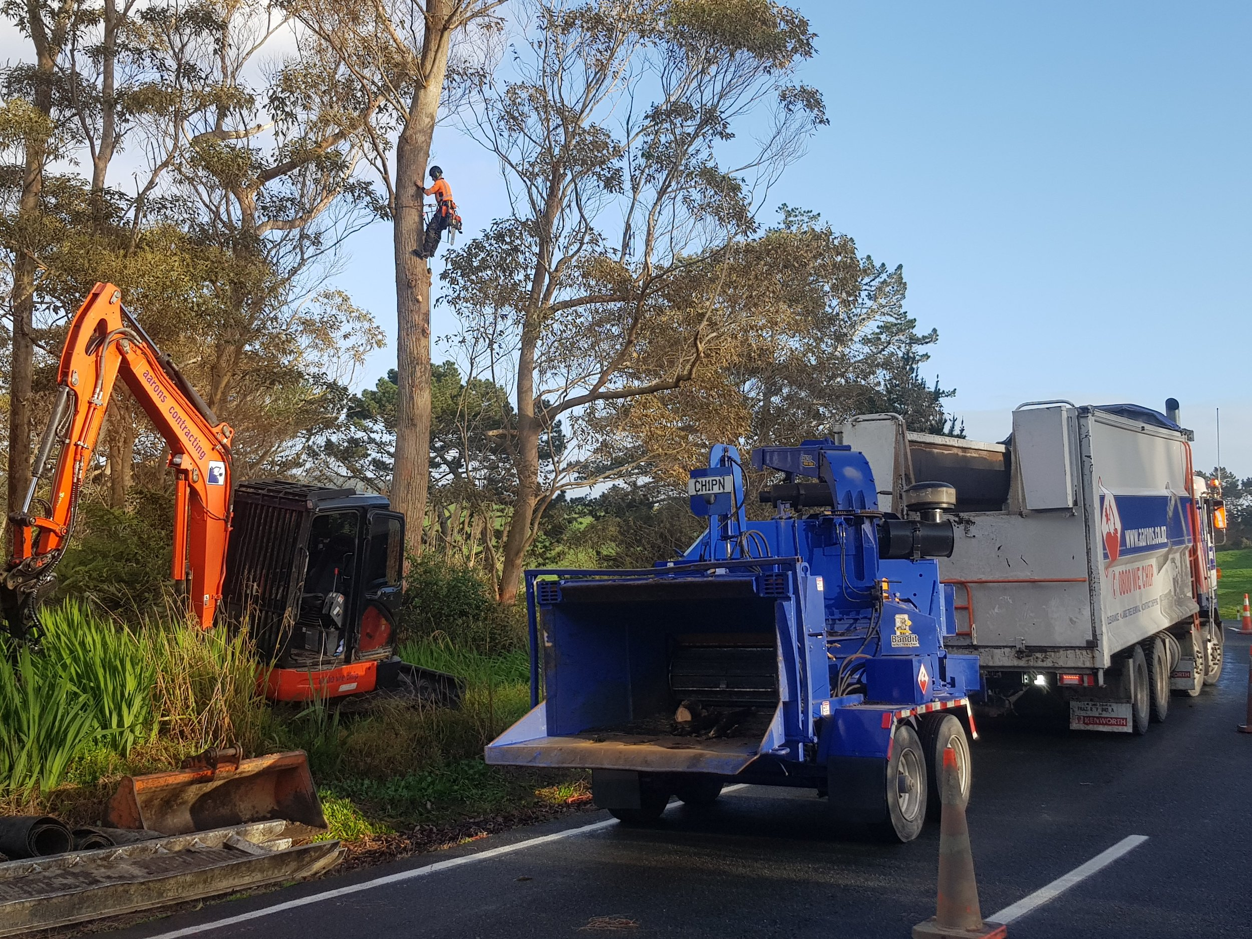 Whole tree chipper, digger and large truck from Aarons contracting