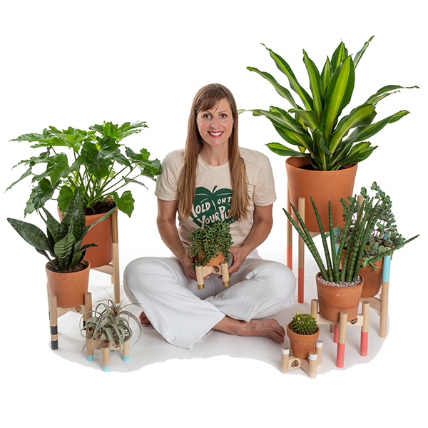 Hold on to Your Plants® - by Carly WeaverInspired by mid century design, a love of plants and color, Hold on to Your Plants was born in a woodshop in Austin, TX. After years of building wood art panels for oil paintings and renovating my 1930's bungalow, I gained a few woodworking skills. Surrounded by too many houseplants sitting on the floor, I made my first planter. From my house to yours: plant stands, decor, plants and botanical prints.