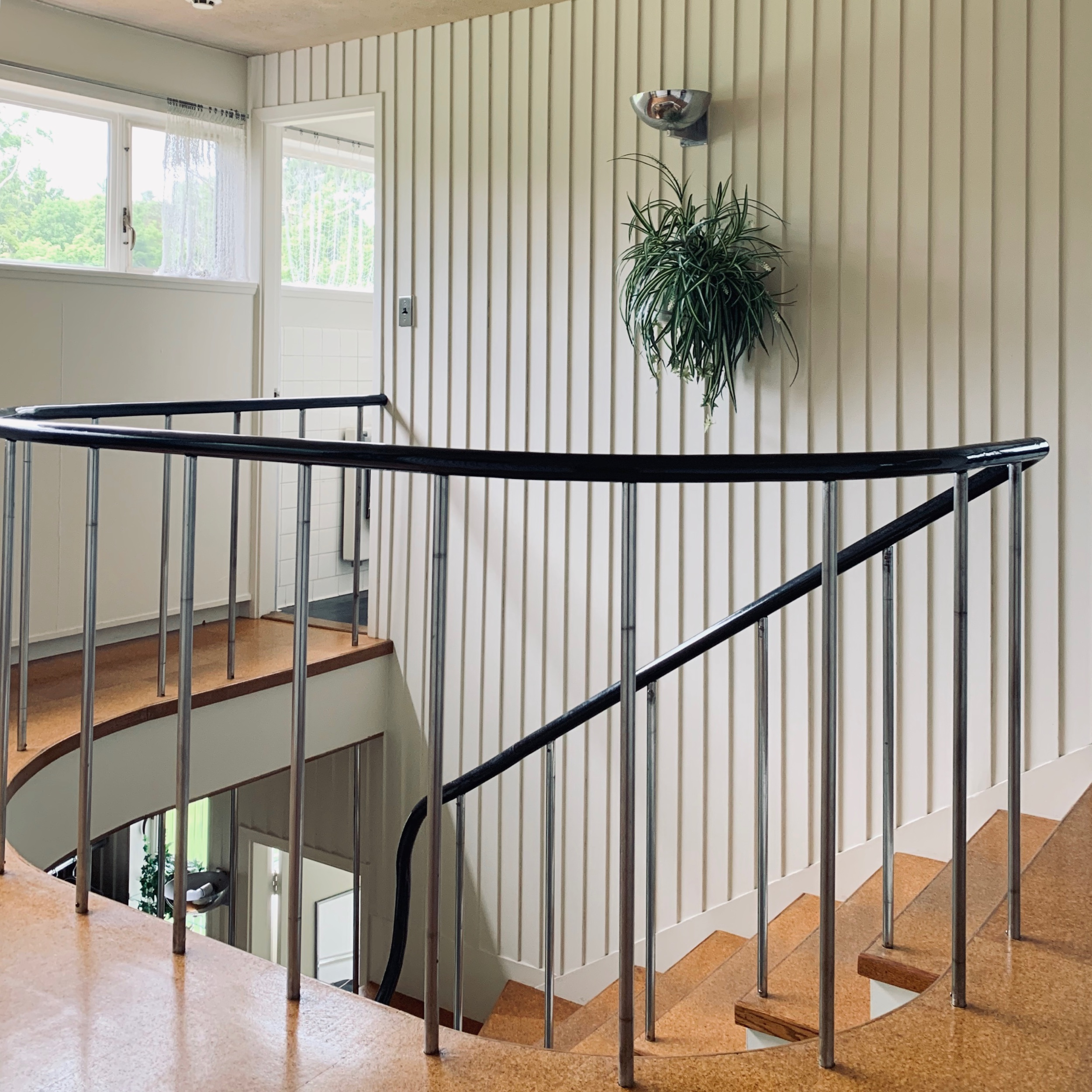 The stair and public floors are clad in Cork Tiles. The stair case design and balustrade rails are slightly curved to reflect the New England vernacular.