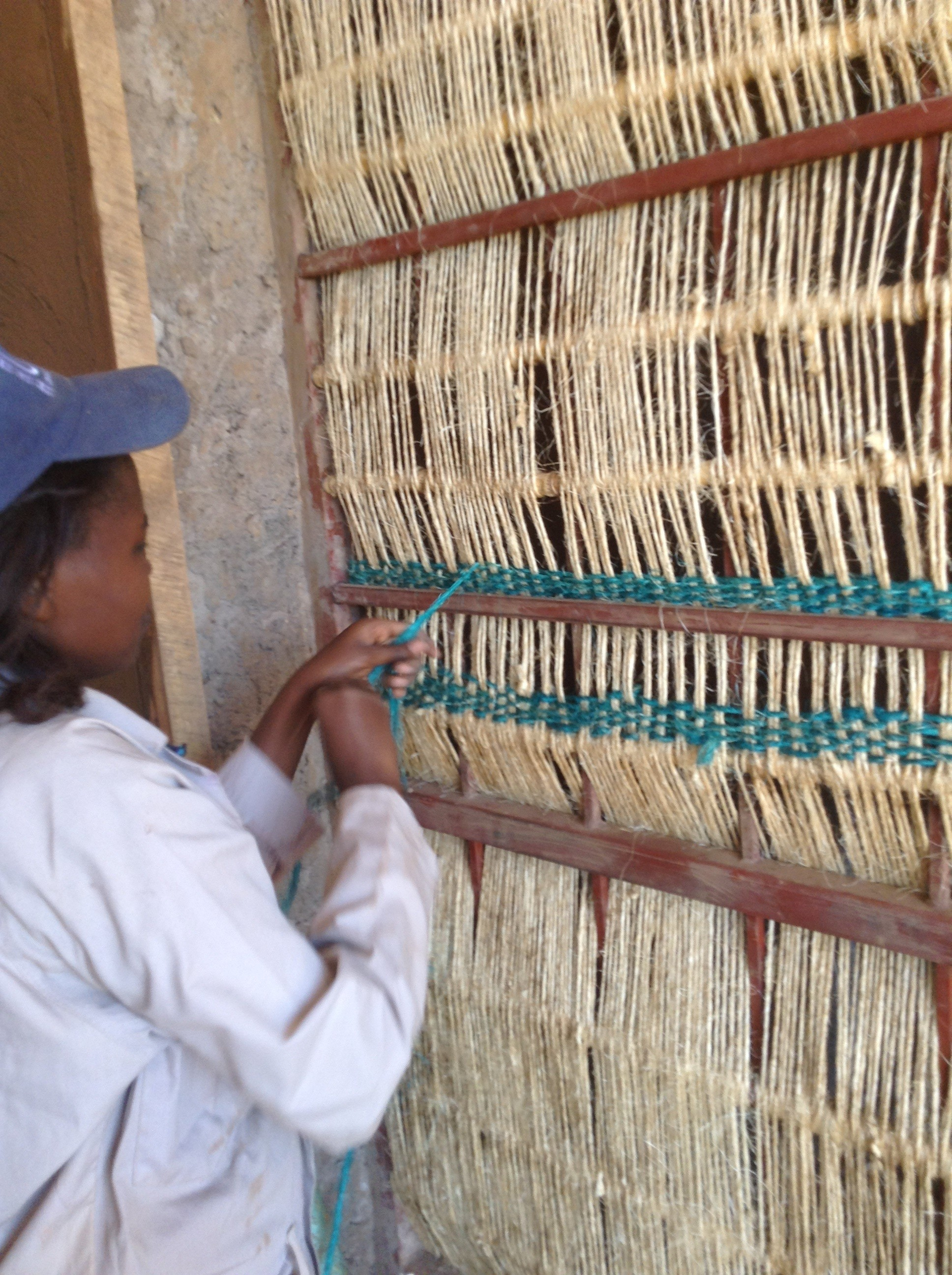 A hand-woven screen provides privacy for the cooking space. The use of vernacular materials and building practices in Rwanda is as much evidence of economic expediency as cultural concern. Image © Yutaka Sho