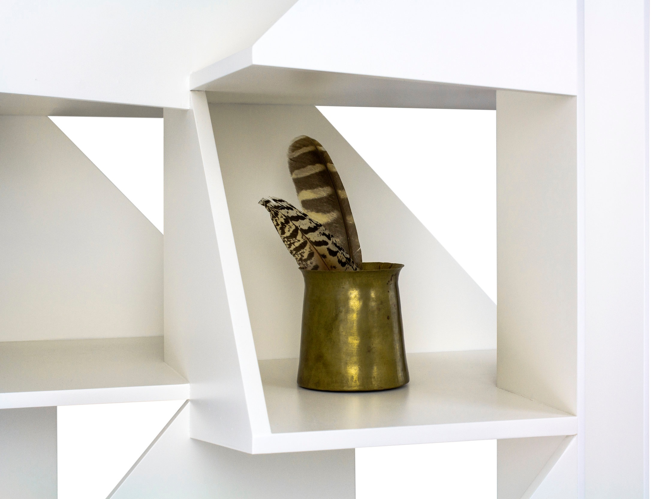 Angular, nested cubbies create displays for books or objects