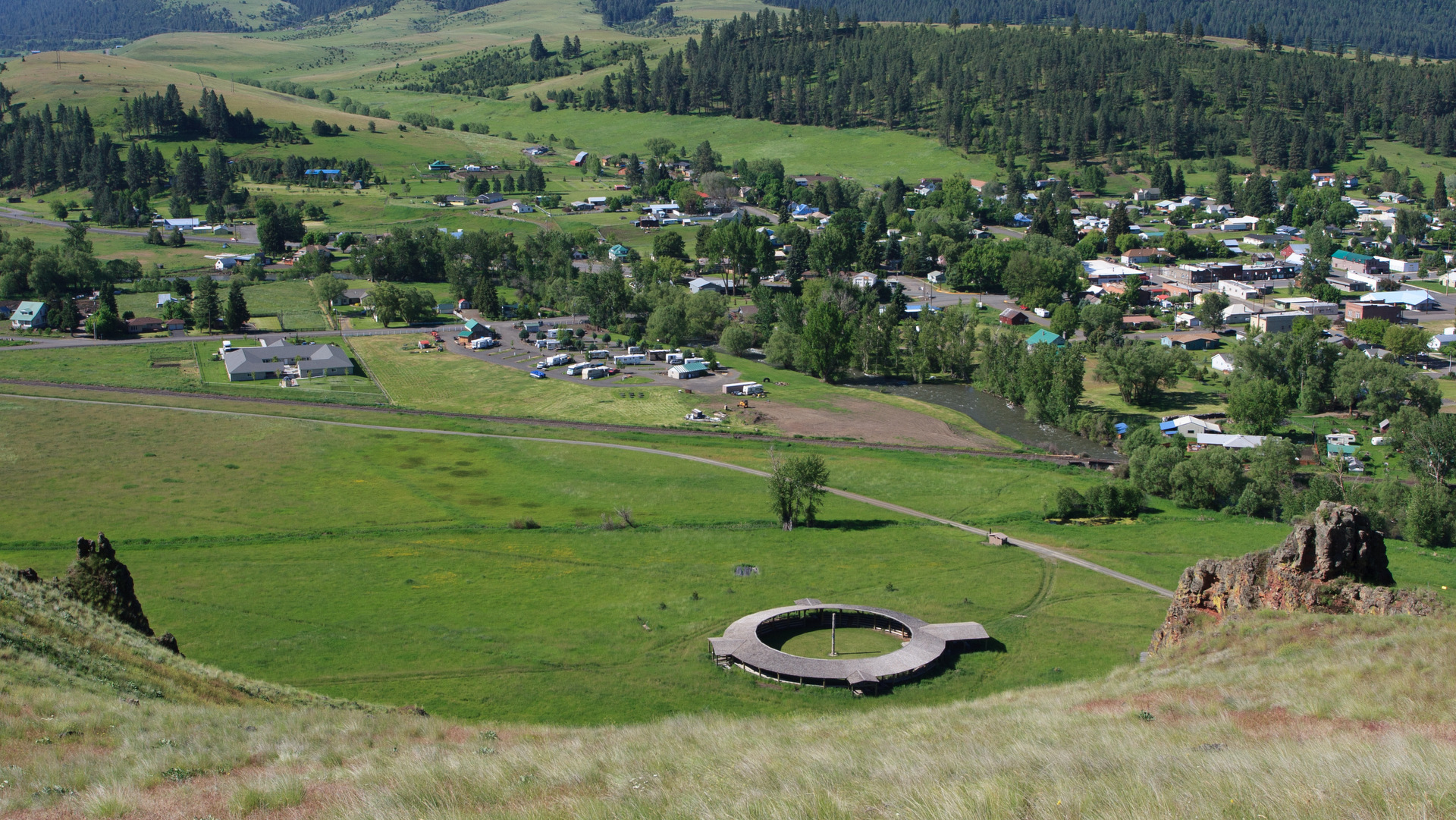 View from the Tick Hill hiking trail of the Dance Arbor at the Nez Perce Wallowa Homeland In Wallowa, OR.