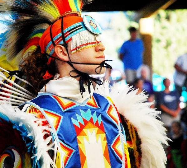 Photo from Wallowa County Chieftain: Chieftain archive Colorful costumes worn by young and old are always in fashion during The Nez Perce Wallowa Homeland Project's Tamkaliks Celebration.