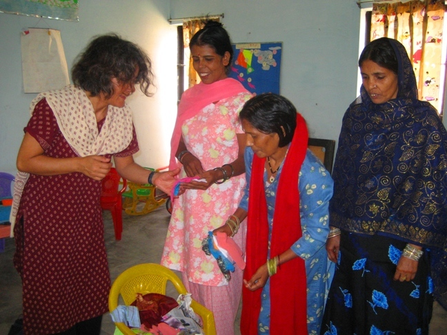 A piece of good news, the mothers have started to learn sewing and stitching. We feel happy because this opportunity will help them to lead a better life in prison and also when out of prison. The mothers showing their work proudly to one of our Yoga students.