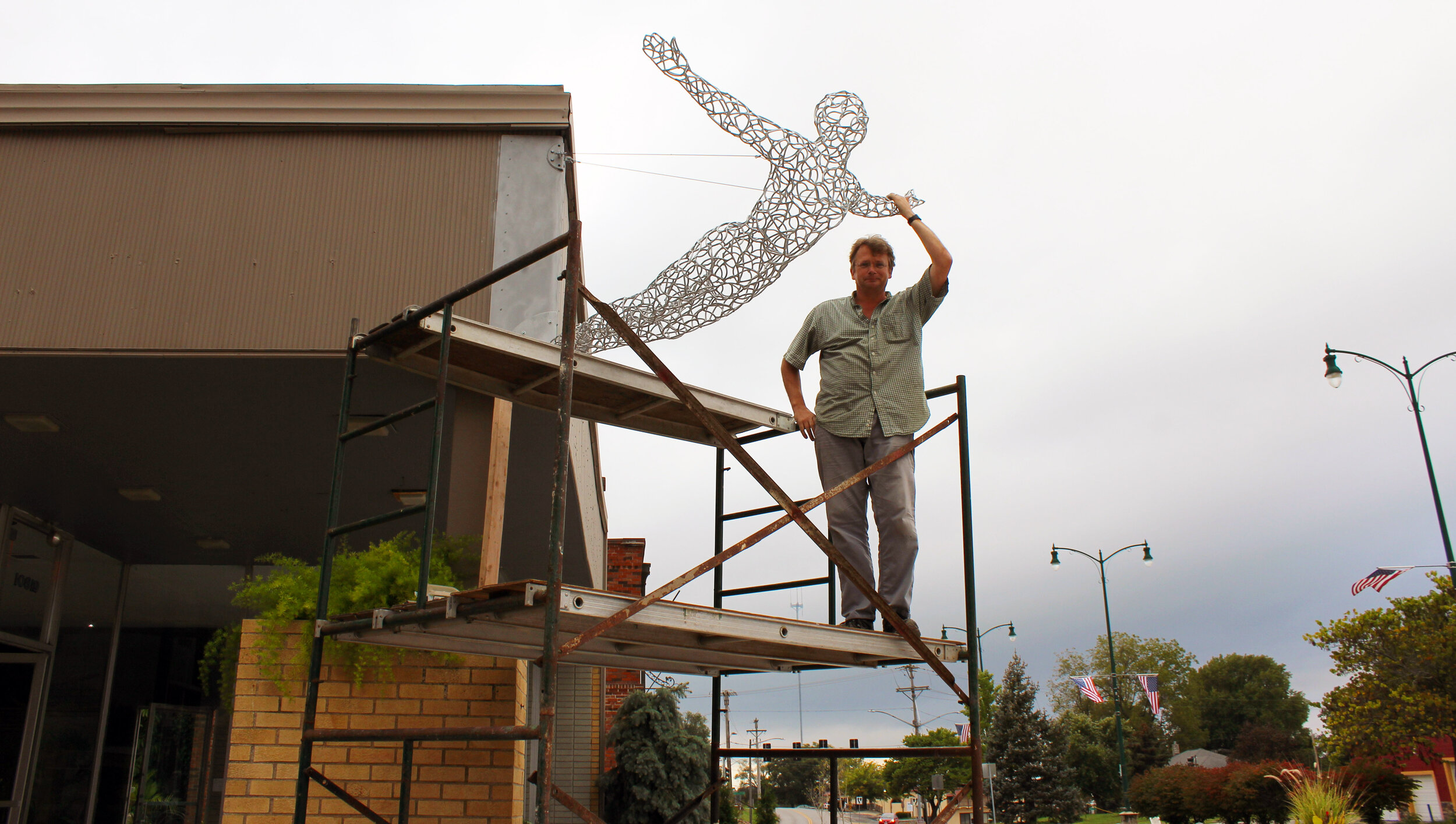 swan-diver-sculpture-by-Michael-Gard-for-Swan-Dive-Event-Center.jpg