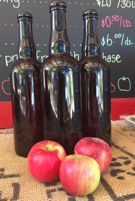 Cider bottles and apples.JPG