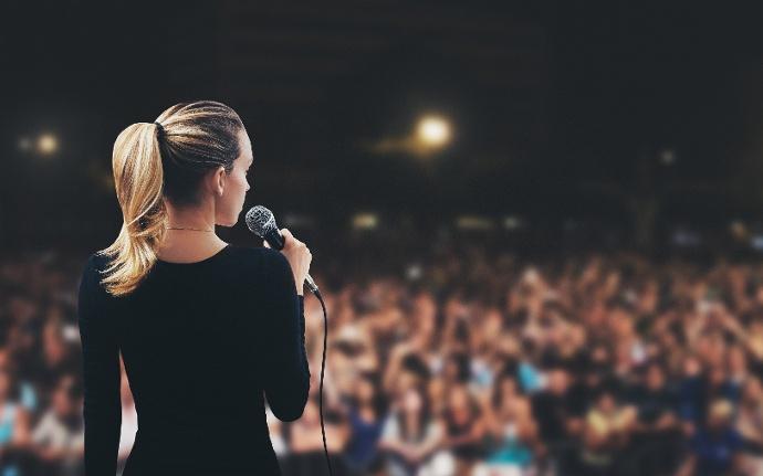 public_speaking_stage_woman.jpeg