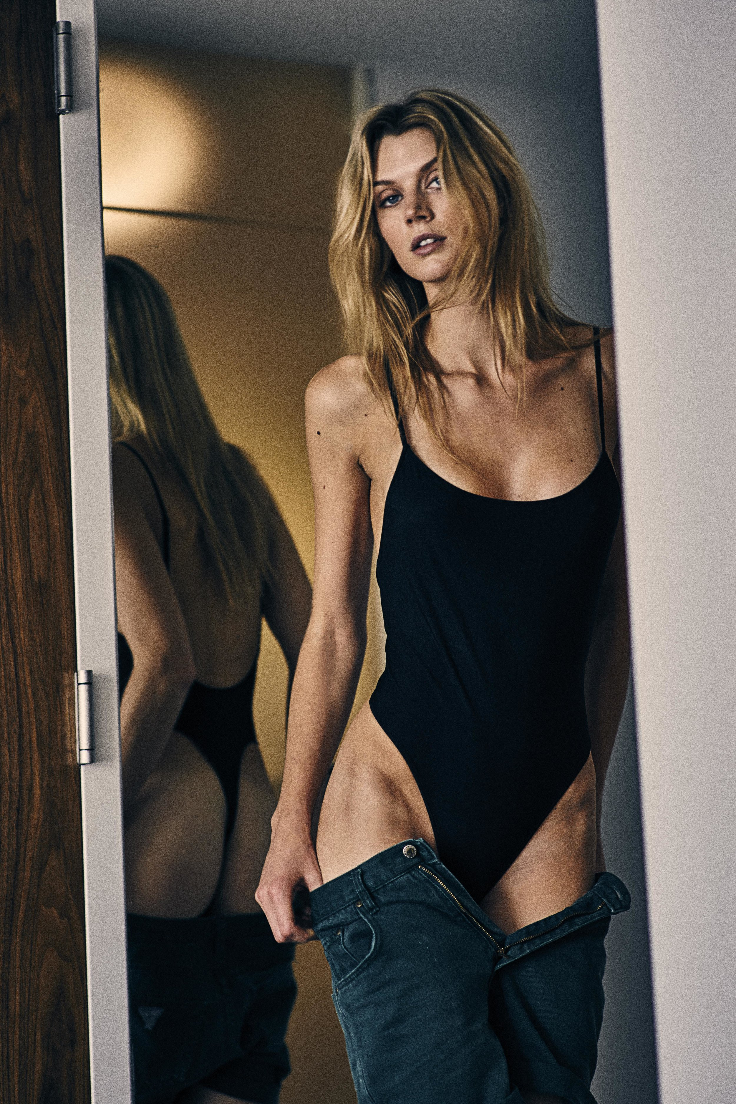 Jayne Moore and WIll Vendramini hotel room series body suit