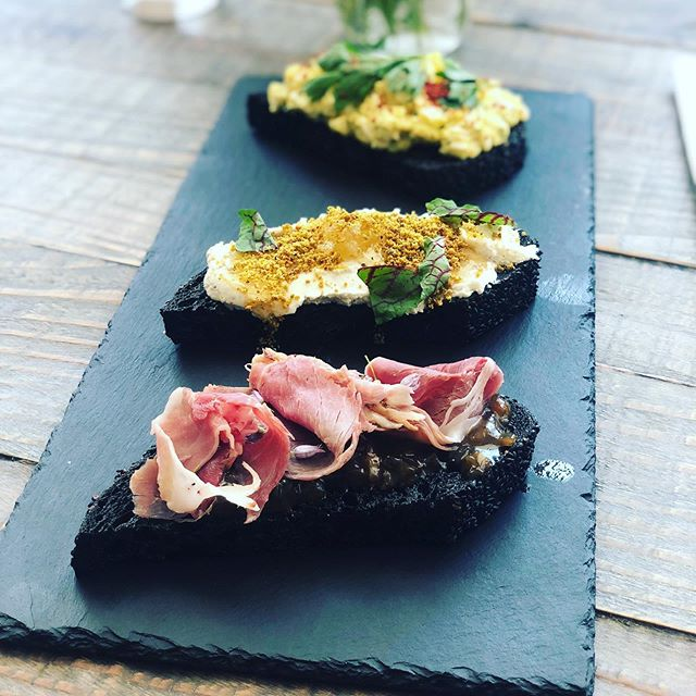 Name a better trio....we will wait! . . Farm House Toasts . Noble Spring's chevre, truffled honey & pistachio . Farm egg salad & lovage . Spring onion jam & house cured ham