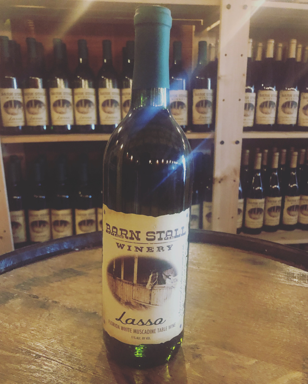 Lasso - Florida White Muscadine Table Wine. Says just enough for when you're wanting to take her by the hand and go for a walk throught the pasture. 11% alc