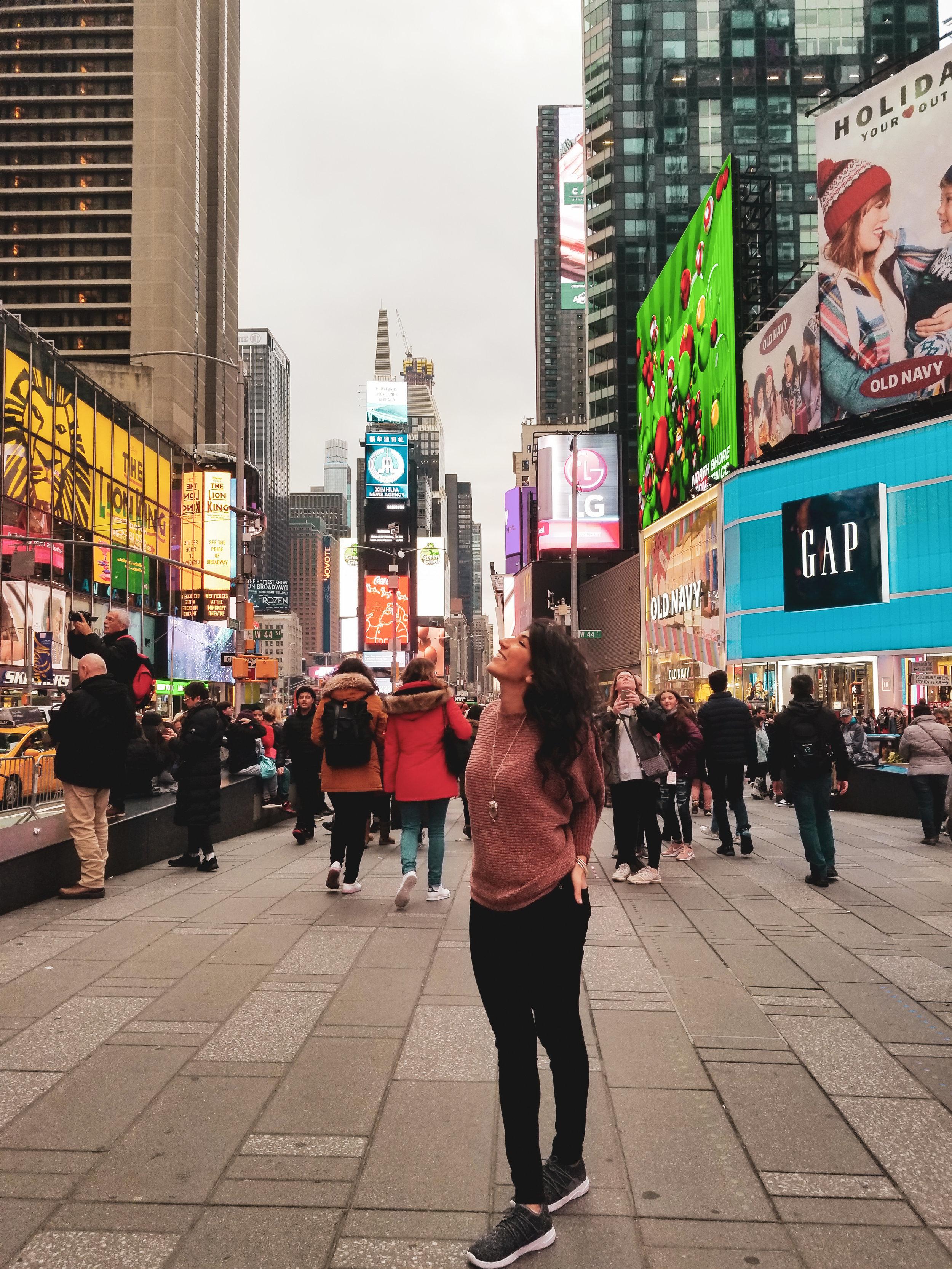 Times Square, wearing  Vessi Footwear