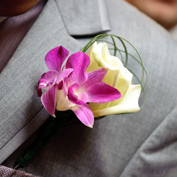Rose and Orchid Boutonniere: $25